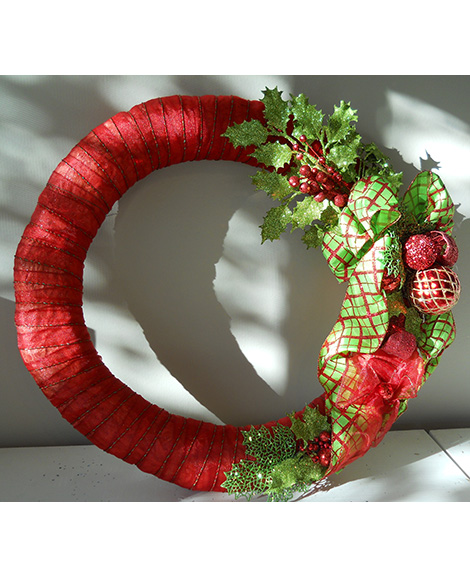 Wreath Wrapped In Beautiful Red Ribbon With Christmas